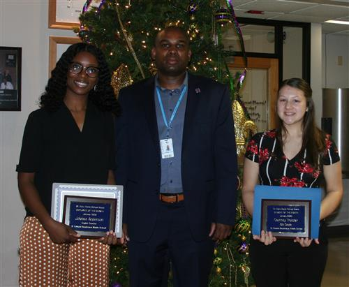 Joleisa Anderson, Ronnie Louis and Courtney Trosclair with their awards