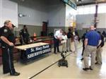 Police and kids at career day