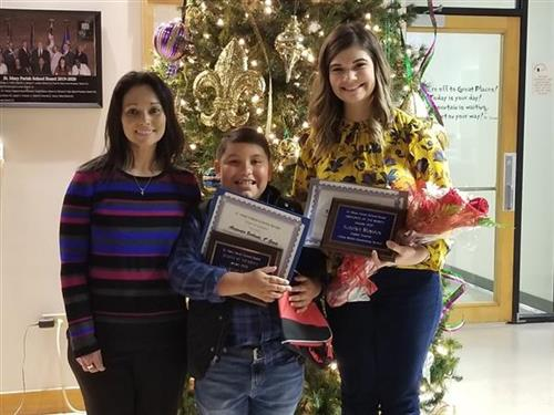Mrs. Gibbons, Alexander Burbante, and Katelyn Mayeux with certificates